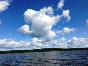 Unidentified fat white cloud does the Macarena over Oak Lake, Ontario, Canada
